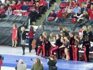 Coach and team watch the beam