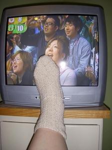 Game show audience cheers mai sock.