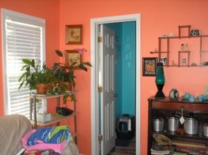 Orange room, turquoise bathroom